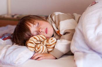 Во сне ребенок скрежет зубами